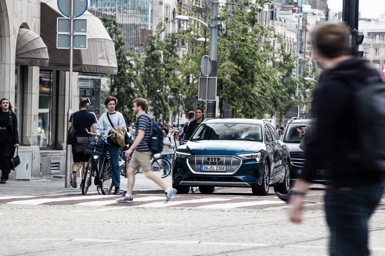 Audi e-tron blending in a city street.