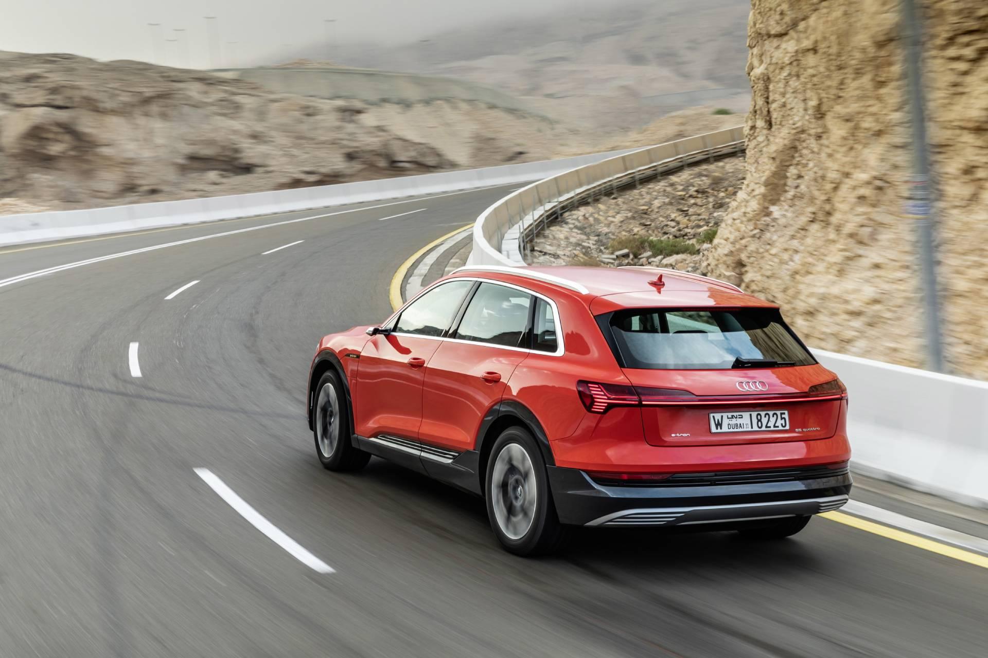 Audi e-tron on winding road.