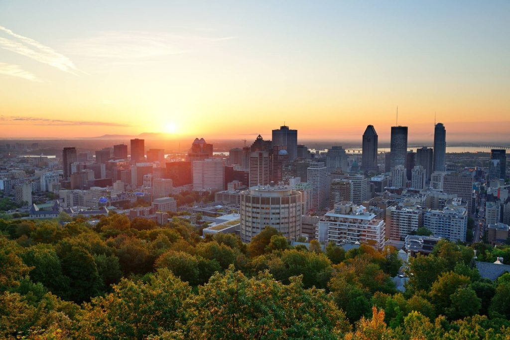 Montreal sunrise from Mount Royal. Credit: Songquan Deng / Shutterstock